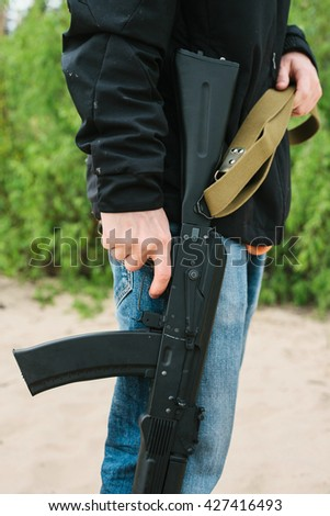 criminal with a weapon - stock photo