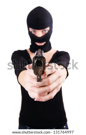 Criminal with gun isolated on white - stock photo
