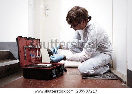 Criminologist and his suitcase - stock photo