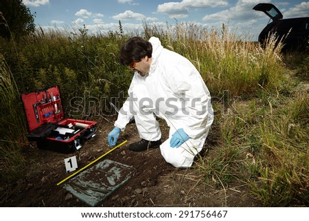 Criminologist technician on reported place of find - stock photo