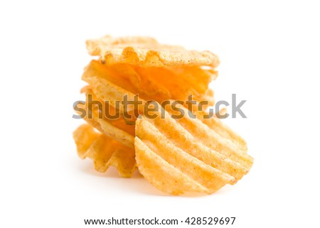 Crinkle cut potato chips isolated on white background. Pile of tasty potato chips. - stock photo