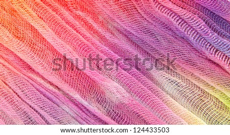 Crinkly, loosely woven  material with bright  tie dyed colors - stock photo