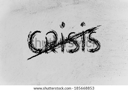 crisis end writing on blackboard - stock photo