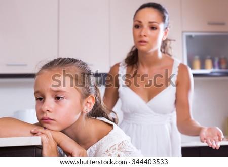 Crisis of motherhood: young woman preaching daughter - stock photo