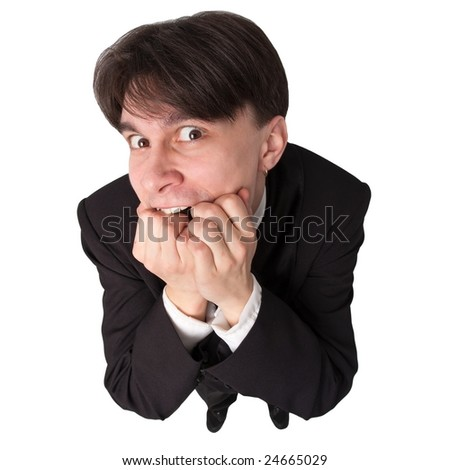 crisis. Stressed businessman standing against isolated white background - stock photo