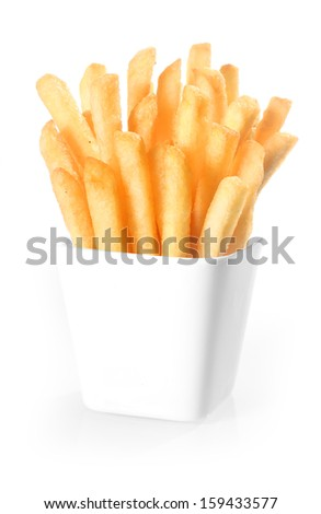 Crisp deep-fried golden potato chips, or French fries, standing upright in a plain white ceramic container over a white background - stock photo