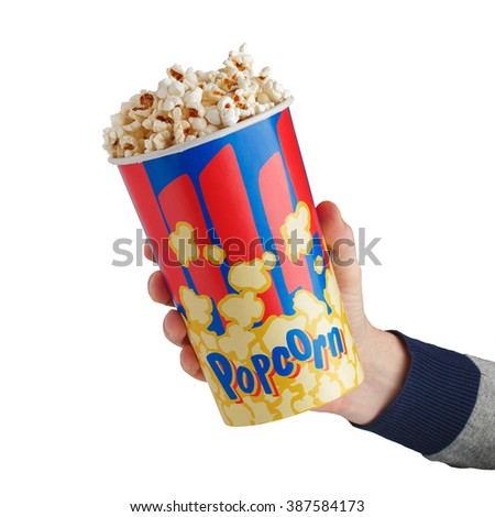 crisp fresh popcorn in a box in the hand isolated on white background - stock photo