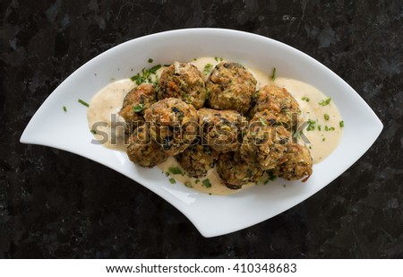 Crisp fried mussel meat balls with vegetables - stock photo