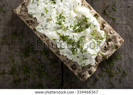 Crispbread with cheese cream made with onion and dill - stock photo