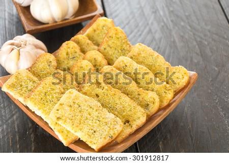 crispy bread garlic on wood background - stock photo