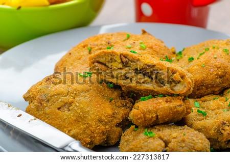 Crispy breaded mushroom schnitzel with french frits - stock photo