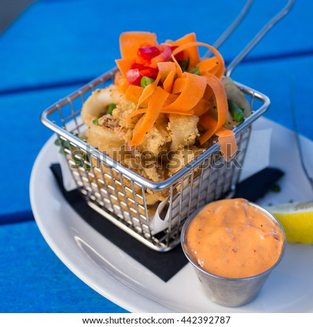 Crispy calamari with spicy remoulade  - stock photo