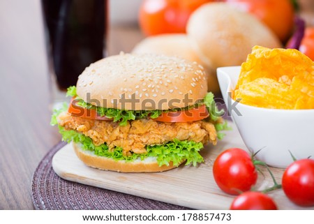 Crispy Chicken Burger and chips - stock photo