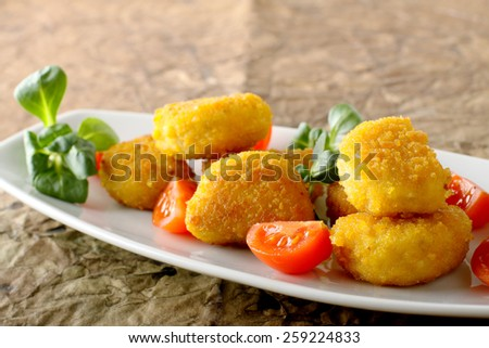 Crispy chicken nuggets on complex background - stock photo