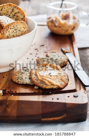 Crispy Cookies with Black Sesame Seeds and Peanut Butter as breakfast on the chopping board - stock photo