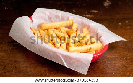 crispy crinkle cut french fries with gravy and ketchup - stock photo