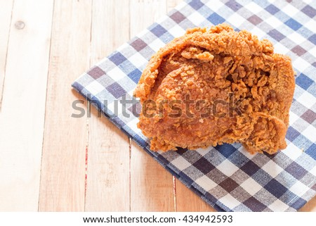 Crispy fried chicken on napkin,Delicious fried chicken on wooden background. - stock photo
