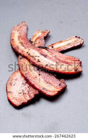 crispy organic heritage smoked bacon from a local organic farm - stock photo