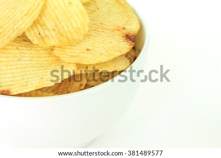 crispy potato chips junk food unhealthy food on bowl white background - stock photo