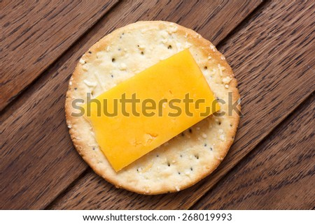 Crispy round cheese cracker from above. With cheese. - stock photo