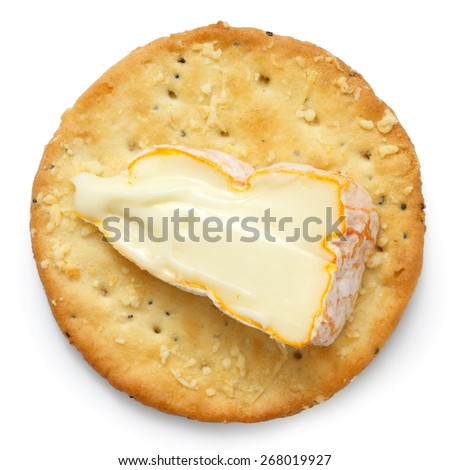 Crispy round cheese cracker from above. With French cheese. - stock photo