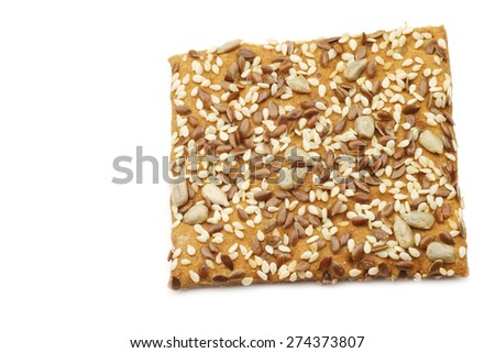 crispy spelt cracker with mixed seeds on a white background - stock photo