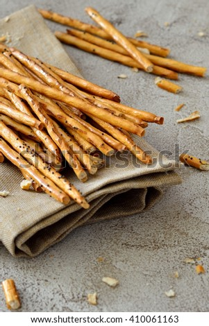 Crispy straw is scattered on a black table with space - stock photo