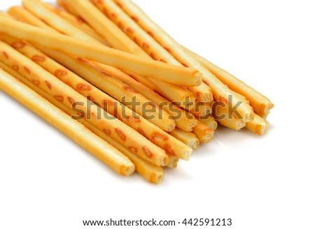 crispy straw on white background. Biscuit sticks - stock photo