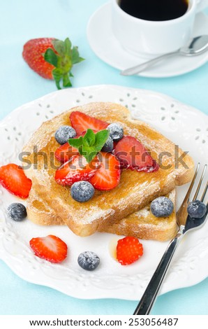 crispy toast with honey, fresh strawberries and blueberries, cup of coffee for breakfast, vertical, closeup - stock photo