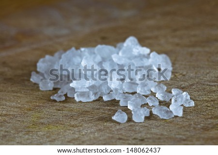 Cristals of salt on the table - stock photo