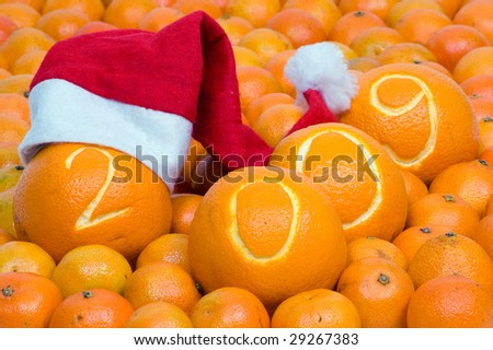 cristmas cap on orange  with a date - stock photo