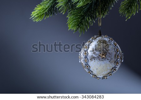 Cristmas. Christmas ball. Luxury christmas ball on christmas tree. Home made Christmas ball hanging on pine twig. - stock photo