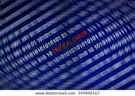 Critical error text in the middle of the computer screen surrounded by one and zero numbers. Spin blur effect is applied to emphasize the text in the middle. - stock photo