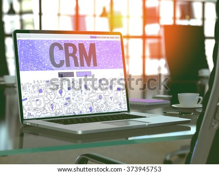 CRM - Customer Relationship Management - Concept - Closeup on Landing Page of Laptop Screen in Modern Office Workplace. Toned Image with Selective Focus. 3d Render. - stock photo