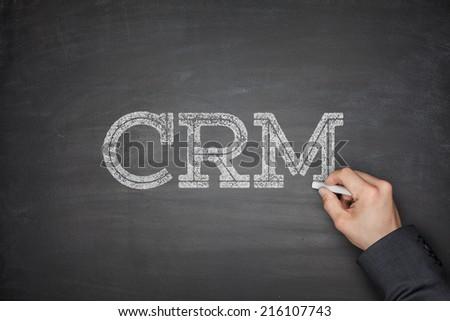CRM - Customer Relationship Management concept on blackboard - stock photo