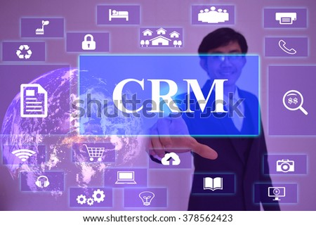 CRM - Customer Relationship Management concept  presented by  businessman touching on  virtual  screen ,image element furnished by NASA - stock photo