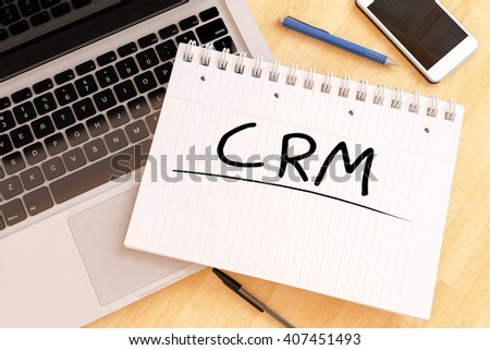 CRM - Customer Relationship Management - handwritten text in a notebook on a desk - 3d render illustration. - stock photo