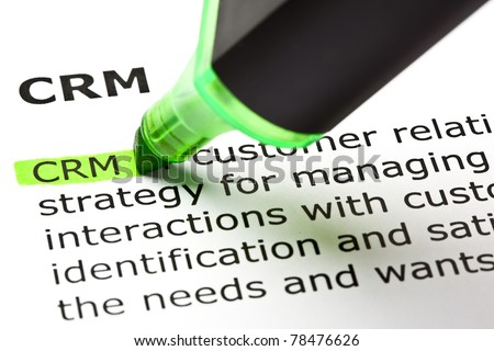 CRM - Customer relationship management, highlighted with green marker. - stock photo