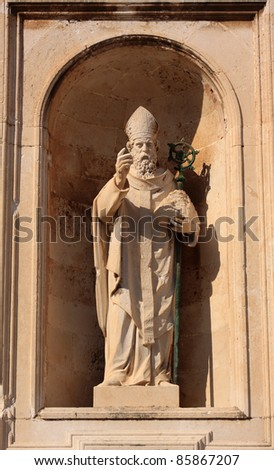 Croatia Dubrovnik Historical center UNESCO World Heritage Site restored after being damaged by heavy bombardments in the Balkan war - late baroque religious sculpted  figure - stock photo