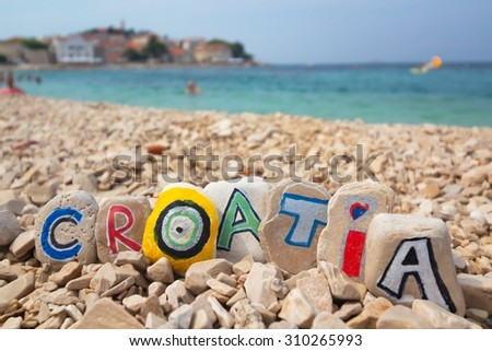 Croatia paint on stones on the beach adriatic sea background - stock photo