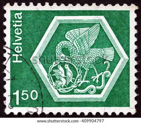 CROATIA ZAGREB, 21 FEBRUARY 2016: a stamp printed in the Switzerland shows Ceiling medallion, Bird Feeding Nestlings, Stein and Rhein Convent, circa 1974 - stock photo