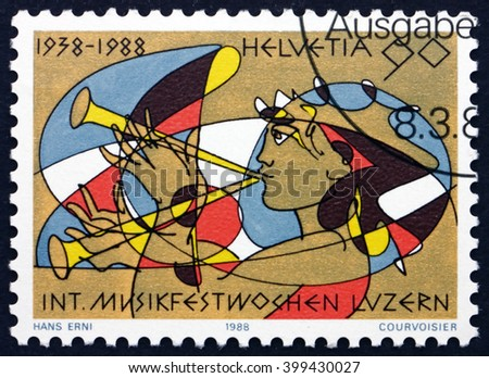 CROATIA ZAGREB, 7 FEBRUARY 2016: a stamp printed in the Switzerland shows Girl Playing a Shawm, International Music Festival Lucerne, 50th Anniversary, circa 1988 - stock photo