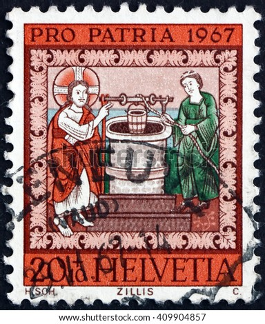 CROATIA ZAGREB, 21 FEBRUARY 2016: a stamp printed in the Switzerland shows Jesus and the Samaritan Woman at the Well, circa 1967 - stock photo