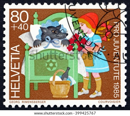 CROATIA ZAGREB, 7 FEBRUARY 2016: a stamp printed in the Switzerland shows Little Red Riding Hood, Fairy Tale by Jakob and Wilhelm Grimm, circa 1985 - stock photo