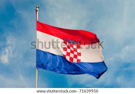 croatian flag on a pole over beautiful sky - stock photo