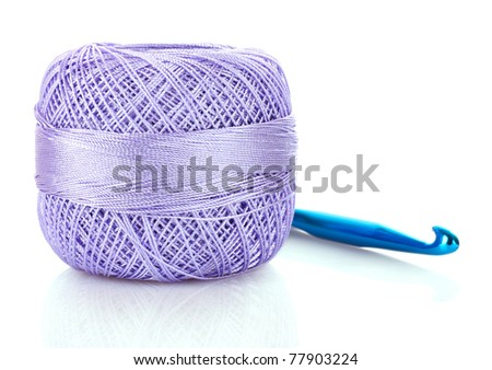 Crochet hook and wool ball isolated on white - stock photo