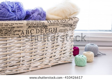 Crochet hooks and balls of yarn on wooden background with copy space Basket with hue knitting yarns hobby  handmade, tailor, hand sewing and knitting theme design. - stock photo