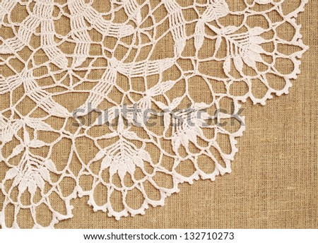 Crochet lace on canvas background - stock photo