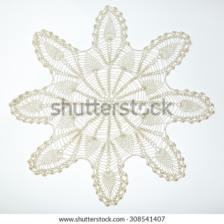 Crocheted lace napkin as home decoration on white - stock photo