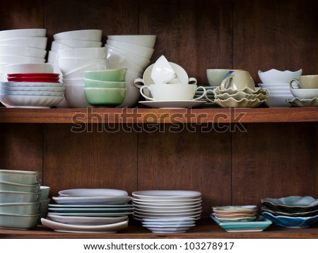 Crockery in the wood larder - stock photo